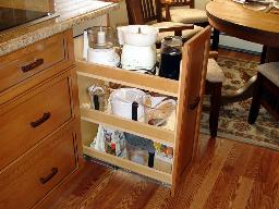A PULLOUT MINI-PANTRY HAS A VARIETY OF USES.