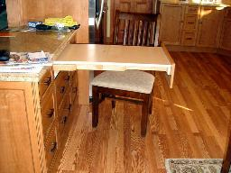 A PULLOUT DRAWER REVEALS A HIDE-AWAY TABLE FOR EXTRA WORK SPACE!
