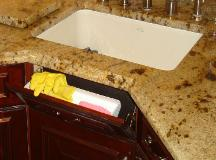 TIP-OUT TRAY CONVENIENTLY HIDES MESSY SPONGES!
