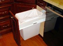 CONCEALED TRASH CAN IS THE ULTIMATE IN CONVENIENCE!