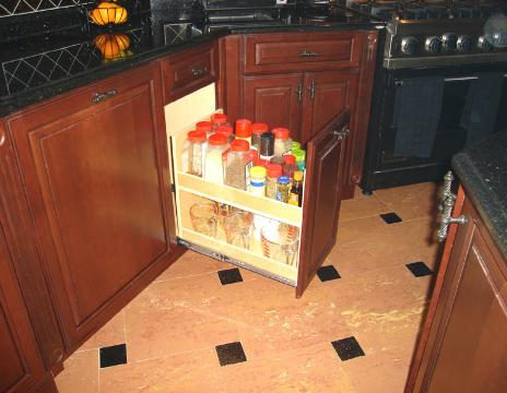 A PULLOUT SPICE PANTRY NEAR THE RANGE PUTS SPICES AND OILS IN EASY REACH!
